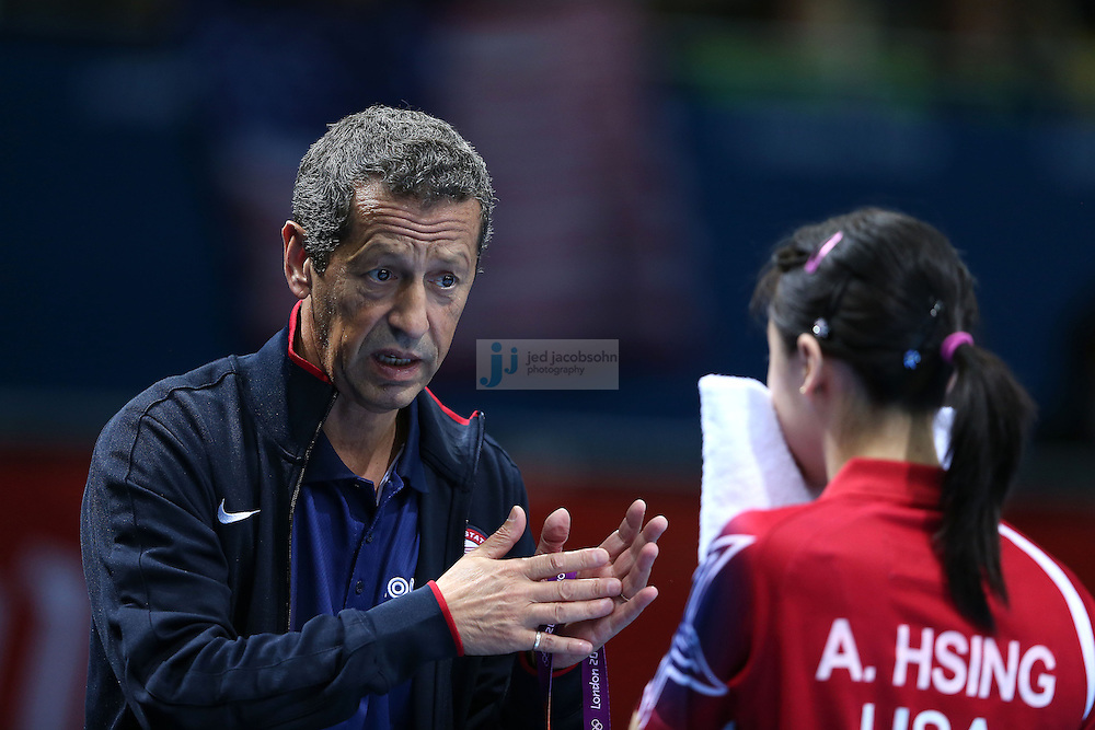 Ariel Hsing of the USA talks with her coach Dennis Davis during her match against Lain Ni Xia of Luxembourg at a table tennis match at the Olympic Games in London, England, United Kingdom, on 29 Jul 2012..(Jed Jacobsohn/for The New York Times)....