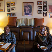 Mr. Johnson and his caretaker Reggie Griffin have dinner together. John E. Johnson, who is not eligible for medicaid, receives services for 12 hours per week through Illinois' Community Care Program. Johnson worries his services will be cut if the state transition seniors like him to a new program. The state employs Reggie Griffin to help Johnson with daily chores so he is able to stay in his home, as opposed to going to an nursing home. <br /> Photography by Jose More