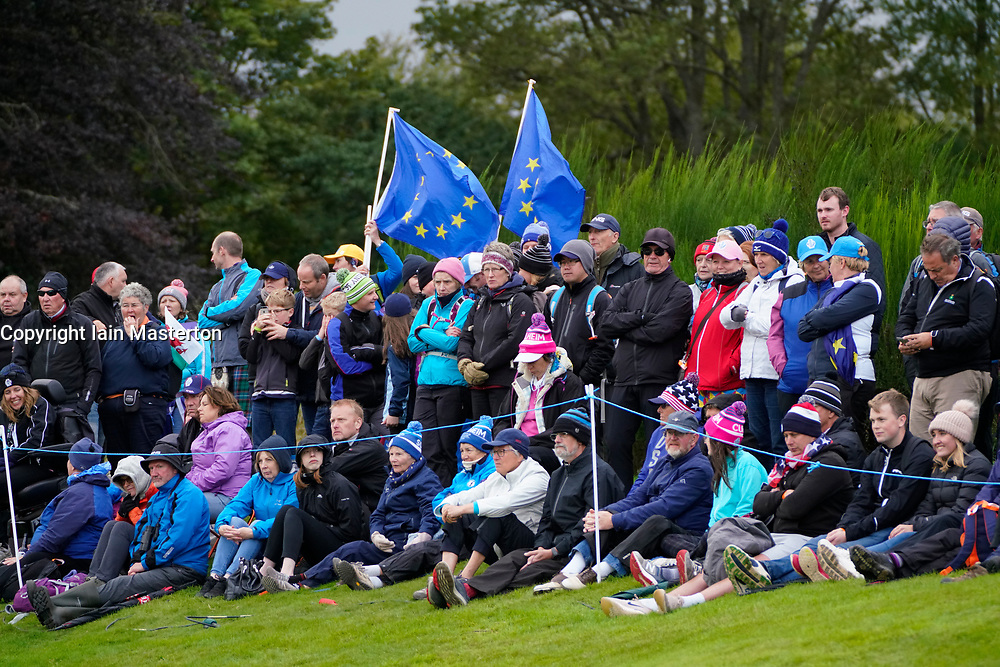 Auchterarder, Scotland, UK. 14 September 2019. Saturday afternoon Fourballs matches  at 2019 Solheim Cup on Centenary Course at Gleneagles. Pictured; Team Europe fans with flags beside the 11th green. Iain Masterton/Alamy Live News