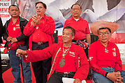 "Mar. 27, 2010 - BANGKOK, THAILAND:  Red Shirt leaders Veera Musigapong (seated left) and Dr Weng Tojirakarn (seated right) wait to speak at the Red Shirt rally in Bangkok Saturday, March 27.  More than 80,000 members of the United Front of Democracy Against Dictatorship (UDD), also known as the ""Red Shirts"" and their supporters marched through central Bangkok March 27 during a series of protests against and demand the resignation of current Thai Prime Minister Abhisit Vejjajiva and his government. The protest is a continuation of protests the Red Shirts have been holding across Thailand. They support former Prime Minister Thaksin Shinawatra, who was deposed in a coup in 2006 and went into exile rather than go to prison after being convicted on corruption charges. Thaksin is still enormously popular in rural Thailand.    PHOTO BY JACK KURTZ"