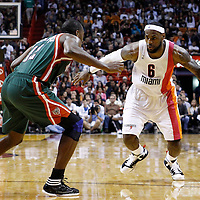 22 January 2012: Miami Heat small forward LeBron James (6) drives past Milwaukee Bucks small forward Luc Richard Mbah a Moute (12) during the Milwaukee Bucks 91-82 victory over the Miami Heat at the AmericanAirlines Arena, Miami, Florida, USA.