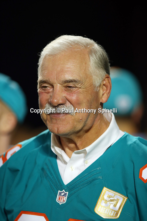 Former Miami Dolphins fullback Larry Csonka smiles during a halftime ceremony honoring the 50 all-time Dolphin great players during the Miami Dolphins NFL week 14 regular season football game against the New York Giants on Monday, Dec. 14, 2015 in Miami Gardens, Fla. The Giants won the game 31-24. (©Paul Anthony Spinelli)