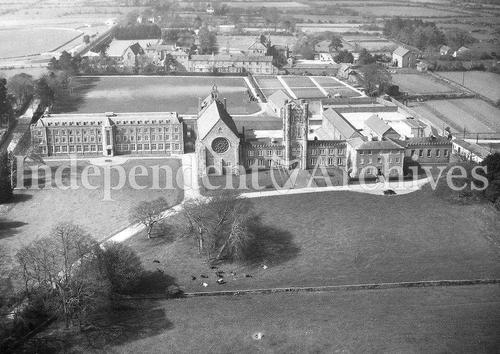 A389 St Peter's College. Wexford.   29/07/55. (Part of the Independent Newspapers Ireland/NLI collection.)<br /> <br /> <br /> These aerial views of Ireland from the Morgan Collection were taken during the mid-1950's, comprising medium and low altitude black-and-white birds-eye views of places and events, many of which were commissioned by clients. From 1951 to 1958 a different aerial picture was published each Friday in the Irish Independent in a series called, 'Views from the Air'.The photographer was Alexander 'Monkey' Campbell Morgan (1919-1958). Born in London and part of the Royal Artillery Air Corps, on leaving the army he started Aerophotos in Ireland. He was killed when, on business, his plane crashed flying from Shannon.