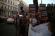 """Julie Christie amongst Protesters on behalf of Kalahari Bushmen objecting to the  De Beers sponsorship. Vanity Fair magazine hosts the """"Diamonds"""" Private View and Launch Party at the Natural History Museum. July 6  London. ONE TIME USE ONLY - DO NOT ARCHIVE  © Copyright Photograph by Dafydd Jones 66 Stockwell Park Rd. London SW9 0DA Tel 020 7733 0108 www.dafjones.com"""