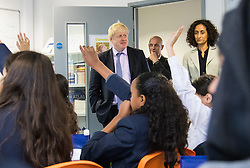 Michaela Community School, Wembley, London, June 23rd 2015. Mayor of London Boris Johnson visits the Michaela Community School, a Free School in Wembley that started taking students in September2014 after battling a certain amount of resistance from locals and unions. During the visit Head Teacher Katharine Birbalsingh took the Mayor on a tour of the school before he participated in a history lesson, prior to sitting down with pupils for brunch. PICTURED: Mayor of London Boris Johnson arrives to take part ina history class, accompanied by Head Teacher Katharine Birbalsingh.