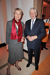 BARONESS VIRGINIA BOTTOMLEY and LORD POWELL at the 38th Veuve Clicquot Business Woman Award held at Claridge's, Brook Street, London W1 on 28th March 2011.