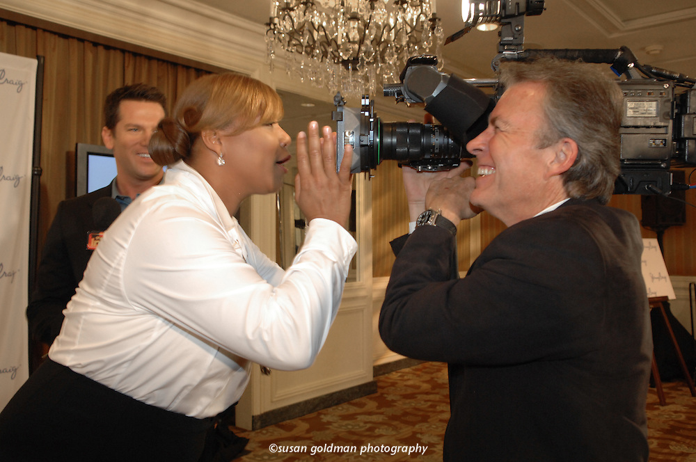 Oscar nominated singer and actress Queen Latifah jokes with cameraman Greg Chasten after she was introduced as the new Jenny Craig client, in Beverly Hills, Calif. Queen Latifah plans to utilize her partnership with Jenny Craig to deliver the positive message of living a healthy lifestyle to her fans. Photo/Jenny Craig, Susan Goldman.
