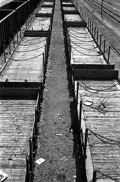 .Old goods carriages with a broken chair in an abandoned goods yard. This scene remained the same through winter and the area like many is sceduled for redevelopment.From Neighborhoods series