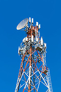 cellular and microwave antennas on a red and white communications tower in Goondiwindi, Queensland, Australia