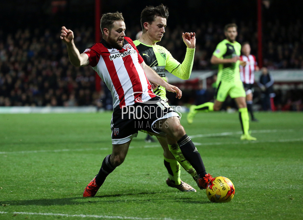 Brentford midfielder Alan Judge winning a penalty and then scoring Brentford fourth goal during the Sky Bet Championship match between Brentford and Huddersfield Town at Griffin Park, London, England on 19 December 2015. Photo by Matthew Redman.