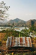 Evening walk up hillside above the Mekong river overlooking Pak Chom village and Laos