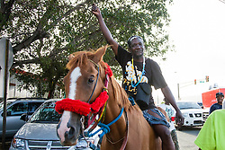 "Sonny Tasha rides ""Scratchy"".  Carnival 2015 continues Jouvert morning on the Watefront.  St. Thomas, VI.  30 April 2015.  © Aisha-Zakiya Boyd"