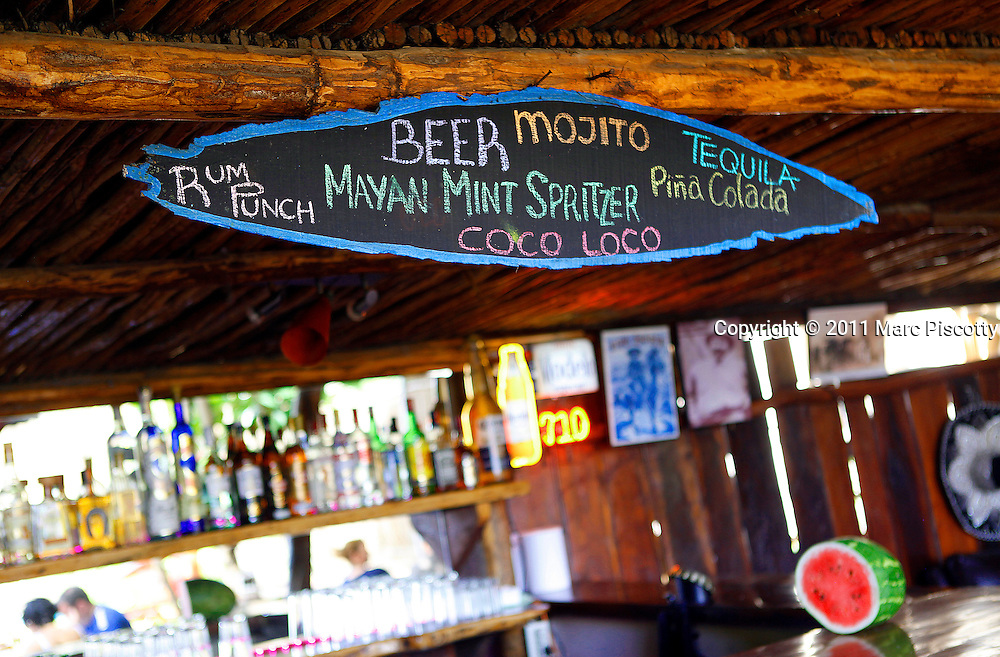 SHOT 11/20/11 1:18:19 PM - A hand printed sign over the bar at Mateo's, a roadside restaurant in Tulum, Mexico. Tulum (sometimes Tulum Pueblo) is the largest community in the municipality of Tulum, Quintana Roo, Mexico. It is located on the Caribbean coast of the state, near the site of the archaeological ruins of Tulum. Several years ago, Tulum Pueblo was a quiet village 2 km (1.5 mi) from the archaeological site, and tourism outside of the ruins was limited to a few small shops and simple cabanas on the beach. (Photo by Marc Piscotty / © 2011)