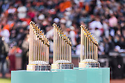 SAN FRANCISCO, CA - APRIL 18:  All three San Francisco Giants World Series trophies are displayed on the field for the Giants World Series ring ceremony at AT&T Park on Saturday, April 18 2015 in San Francisco, California. Photo by Jean Fruth