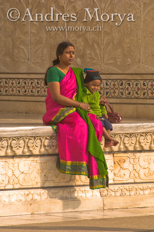 Lady in a traditional Sari standing in front of Mosque Taj Mahal, Agra, India Image by Andres Morya