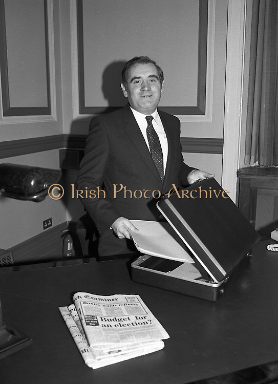 Minister for Finance, Gene Fitzgerald.  (N59)..1981..28.01.1981..01.28.1981..28th January 1981..Minister for Finance, Gene Fitzgerald,is seen preparing for the delivery of his budget to Dáil Éireann..Images show the Minister with the trade mark case which contains the budget.