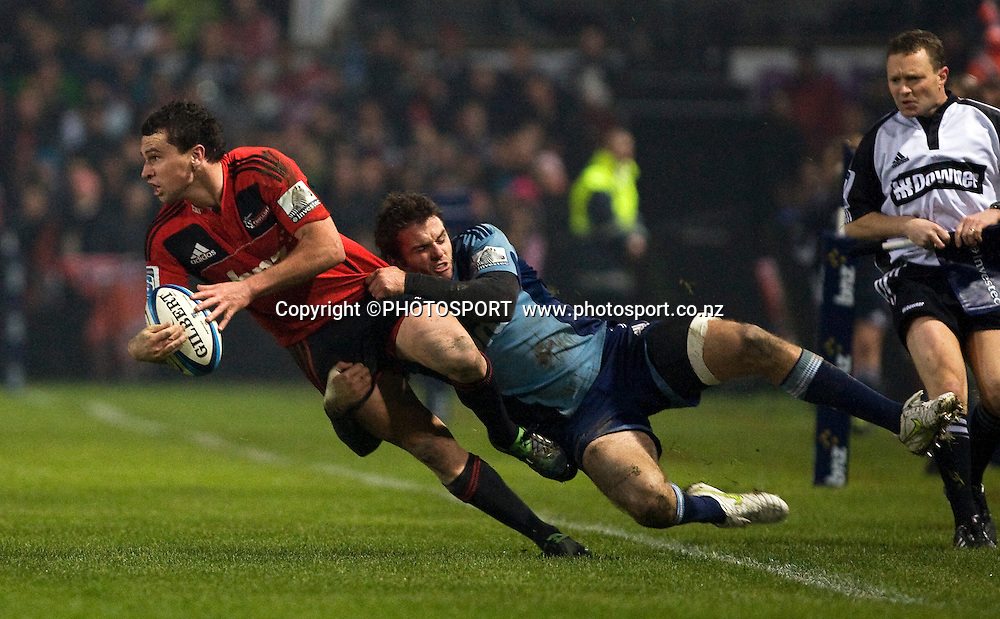 Tom Marshall with the ball for the Crusaders in the tackle of Blues fullback Jared Payne. Canterbury Crusaders v Auckland Blues at Alpine Energy Stadium, Timaru, New Zealand. Saturday 11 June 2011. Joseph Johnson/photosport.