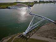 Nederland, Zuid-Holland, Hoek van Holland, 14-09-2019; Nieuwe Waterweg, Haven van Rotterdam. Functioneringssluiting Maeslantkering. De waterkering in de Nieuwe Waterweg wordt een maal per jaar, voordat het stormseizoen begint, getest. Tijdens het sluiten van de kering ligt alle scheepvaartverkeer naar de Rotterdamse haven stil.  Details van de kering, de deuren. De Maeslantkering sluit normaal gesproken alleen bij dreigende stromvloed en bij een waterstand van 3 meter of meer boven NAP. De kering, onderdeel van de Deltawerken, vormt samen met de Hartelkering de Europoortkering en beschermt Rotterdam en achterland bij extreme waterstanden.<br /> Hook of Holland - Port of Rotterdam. Aerial view of the new storm surge barrier (Maeslantkering) in the Nieuwe Waterweg during the so-called functioning closure, taking place one a year before the storm season begins. The waterway, leading to the Port of Rotterdam (at the horizon), is closed during the test. <br /> luchtfoto (toeslag op standard tarieven);<br /> aerial photo (additional fee required);<br /> copyright foto/photo Siebe Swart