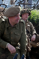Two reenactors portraying infantry men from the East Yorkshire Regiment sit in a dugout during the Ponderosa Wartime Weekend Heckmondwike.<br /> 9th July 2011 Image © Paul David Drabble