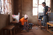 Solar Sister entrepreneur Fatma Mziray delivers a clean wood cookstove to Zainabu Jabiri. Zainabu met Fatma sometime earlier when Fatma was showing the clean cookstoves to women in her village. She liked the stove and decided to get one. She loved the idea that it used a lot less firewood, that it is compact and that it is also a nice looking stove. She sold firewood and charcoal to save money to be able to purchase the stove. Fatma talks with Zainabu and then shows her how the stove works. Near Arusha, Tanzania.   Fatma Mziray is a Solar Sister entrepreneur who sells both clean cookstoves and solar lanterns. Fatma heard about the cookstoves from a Solar Sister development associate and decided to try one out. The smoke from cooking on her traditional wood stove using firewood was causing her to have a lot of heath problems, her lungs congested her eyes stinging and her doctor told her that she had to stop cooking that way. Some days she felt so bad she couldn't go in to cook. Fatma said, &ldquo;Cooking for a family, preparing breakfast, lunch and dinner I used to gather a large load of wood every day to use. Now with the new cook stove the same load of wood can last up to three weeks of cooking. <br /> <br /> &ldquo;With the extra time I can develop my business. I also have more time for the family. I can monitor my children&rsquo;s studies. All of this makes for a happier family and a better relationship with my husband. Since using the clean cookstove no one has been sick or gone to the hospital due to flu.&rdquo;  Fatma sees herself helping her community because she no longer sees the people that she has sold cookstoves have red eyes, coughing or sick like they used to be. She has been able to help with the school fees for her children, purchase items for the home and a cow.<br /> <br /> &ldquo;What makes me wake up early every morning and take my cookstoves and go to my business is to be able to take my family to school as well as to get food and other family n