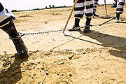 "05 JULY 2001 -- PHOENIX, AZ:  Members of the women chain gang in Maricopa County, Phoenix, AZ, clean up the county's ""Potter's Field"" or cemetery for the indigent. Maricopa county sheriff Joe Arpaio claims to have the only women's chain gang in the United States. He has been criticized for the chain gang but claims to be an ""equal opportunity incarcerator."" He has said that if puts men on a chain gang he will also put women on a chain gang. The women are prisoners in the county jail and volunteer for duty on the chain gang because it gets them out of the jail for six hours a day. The chain gang also buries the county's homeless and indigents. PHOTO BY JACK KURTZ"