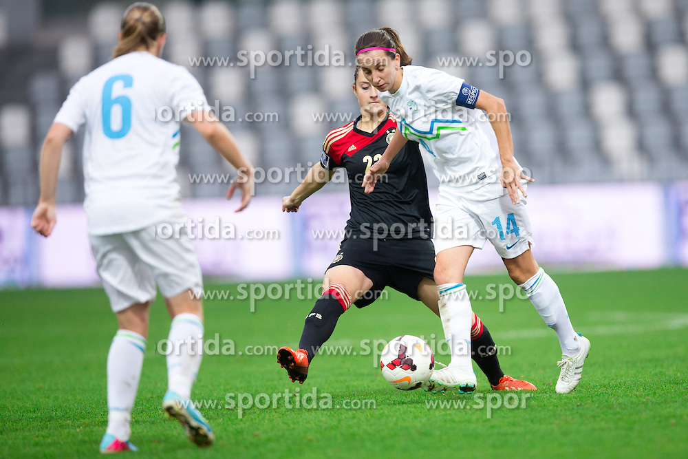 Sara Däbritz of Germany and Anja Milenkovic of Slovenia during FIFA Women's World Cup 2015 Group A qualification match between Slovenia and Germany on October 26, 2013 in SRC Bonifika, Koper, Slovenia. (Photo by Matic Klansek Velej / Sportida.com)