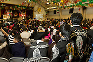 Middletown, New York - Members of St. Joseph's Church watch the celebration of the Festival of Nuestra Senora de Guadalupe in the church gymnasium on Saturday, Dec. 14, 2013.