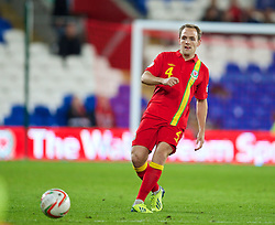 CARDIFF, WALES - Friday, October 11, 2013: Wales' David Vaughan in action against Macedonia during the 2014 FIFA World Cup Brazil Qualifying Group A match at the Cardiff City Stadium. (Pic by David Rawcliffe/Propaganda)