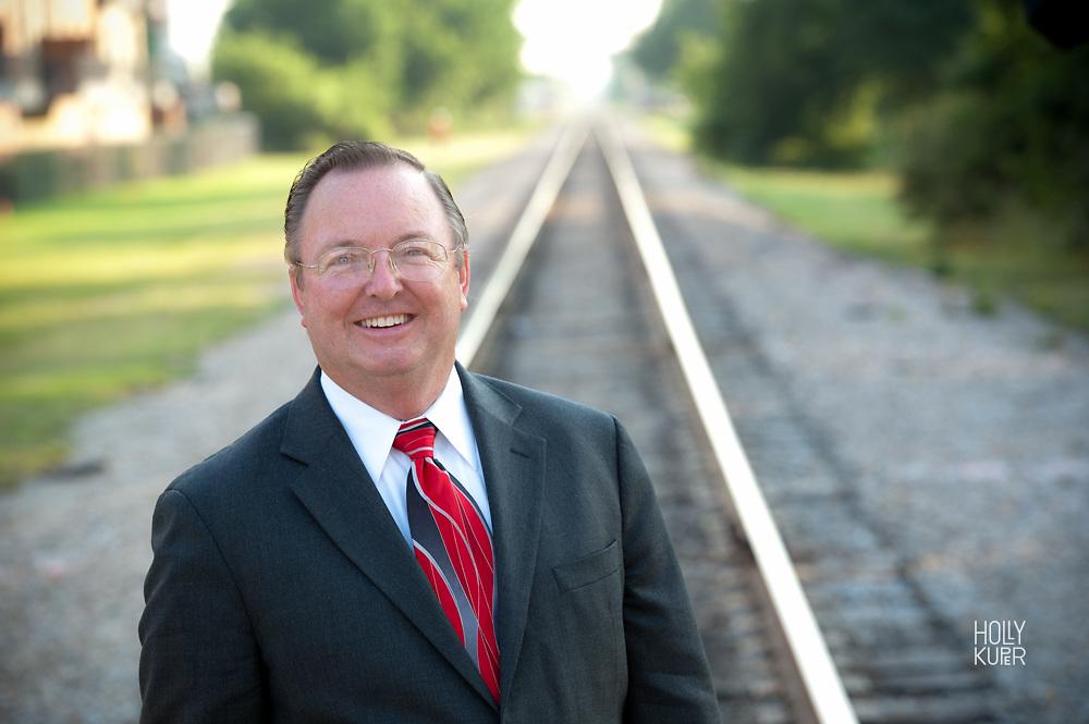 Portrait of a man near railroad tracks