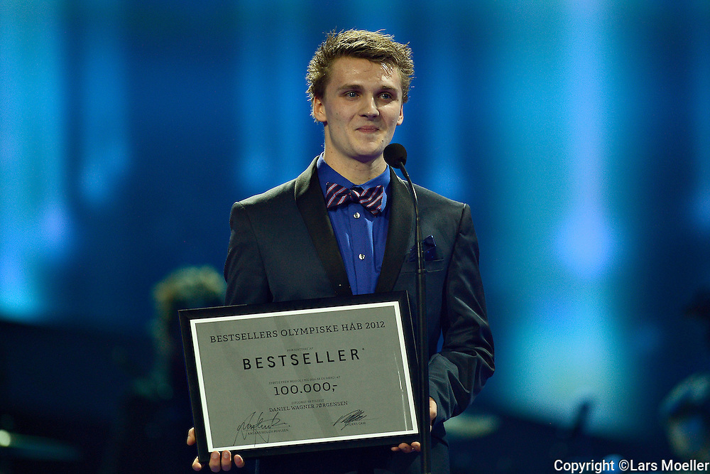 "Herning, Denmark, 20130105, Sport 2012:.Danmarks Radio presents the yearly award show for the best achivements in sports in the year 2012. Jesper Stubkier from Bestseller presents ""Bestsellers Olympiske håb"" . The ward goes to Daniel Wagner Jørgensen..Photo: Lars Moeller"