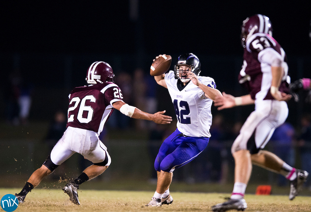 Jay M. Robinson's Justin Kluttz puts pressure on Cox Mill's Shawn Fitzsimonds Friday night at Jay M. Robinson High School n Concord. (Photo by James Nix)