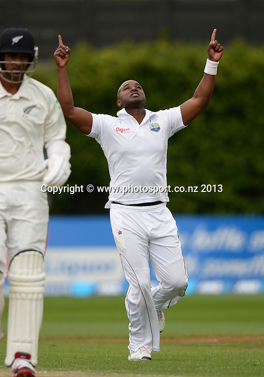 Tino Best celebrates the wicket of Ish Sodhi on Day 2 of the 2nd cricket test match of the ANZ Test Series. New Zealand Black Caps v West Indies at The Basin Reserve in Wellington. Thursday 12 December 2013. Mandatory Photo Credit: Andrew Cornaga www.Photosport.co.nz