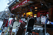 Customers enjoy apres ski dinner at outdoor cafe in ski resort village; Whistler, British Columbia, Canada