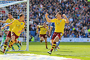 Burnley striker Sam Vokes (9) celebrates Burnley defender Michael Keane (5) equaliser 2-2 Burnley during the Sky Bet Championship match between Brighton and Hove Albion and Burnley at the American Express Community Stadium, Brighton and Hove, England on 2 April 2016. Photo by Phil Duncan.