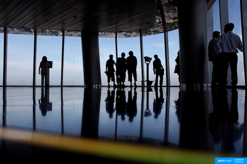 Tourists enjoy the view of Ho Chi Minh City from the viewing level of The Bitexco Financial Tower in Ho Chi Minh City, Vietnam. 3rd March 2012. Photo Tim Clayton