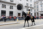 Senior officer of the Household Cavalry rides before the funeral of Margaret Thatcher. Draped in the union flag and mounted on a gun carriage, the coffin of ex-British Prime Minister Baroness Margaret Thatcher's coffin travels along Fleet Street towards St Paul's Cathedral in London, England. Afforded a ceremonial funeral with military honours, not seen since the death of Winston Churchill in 1965, family and 2,000 VIP guests (incl Queen Elizabeth) await her cortege.