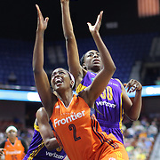 UNCASVILLE, CONNECTICUT- JULY 15:  Camille Little #2 of the Connecticut Sun is fouled by Nneka Ogwumike #30 of the Los Angeles Sparks as she drives to the basket  during the Los Angeles Sparks Vs Connecticut Sun, WNBA regular season game at Mohegan Sun Arena on July 15, 2016 in Uncasville, Connecticut. (Photo by Tim Clayton/Corbis via Getty Images)