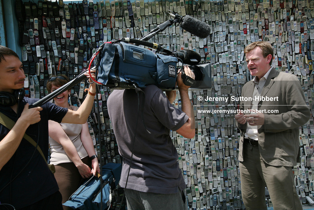 Masanao Watanabe, 57, who owns the Wataden mobile phone shop, has a collection of 6,000 mobile phones which he has been collecting since 1994, some of which he has used to decorate the exterior walls of his shop, in Edogawa-Ku,  Tokyo, Japan, Aug 7th, 2007.