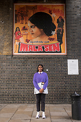 © Licensed to London News Pictures. 18/10/2018. LONDON, UK. Artist Justine Sehra at the unveiling of her new artwork in Brick Lane. The artwork features human rights activist Mala Sen and is one of 20 newly-commissioned artworks, designed by the London Tate Collective team, Tate's group for 16 to 25 year old artists, which will appear in public spaces across the city marking the centenary of women's suffrage.  Called LDN WMN, the artworks celebrate women who have played a crucial role in London's history, but have been largely overlooked.  Photo credit: Stephen Chung/LNP