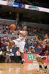 Virginia forward Monica Wright (22) leaps to the basket in action against Rider.  The #15 ranked Virginia Cavaliers defeated the Rider Broncs 83-38 in the Marriott Cavalier Classic Basketball Tournament at the John Paul Jones Arena on the Grounds of the University of Virginia in Charlottesville, VA on December 28, 2008.
