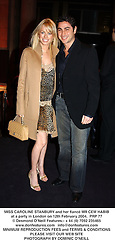 MISS CAROLINE STANBURY and her fiancé MR CEM HABIB at a party in London on 12th February 2004.PRP 77