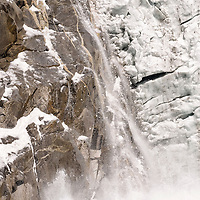 Large chunks of the Northwestern Glacier calve into the ocean. Kenai Fjords National Park, Alaska