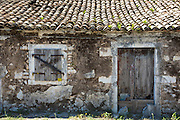Old shabby derelict house with roof tiles and shutters in village of Perithia - Perithea -  Northern Corfu, Greece