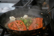 Cooking salmon, Talon Lodge, Sitka, Alaska
