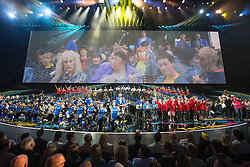 "© Licensed to London News Pictures . 03/07/2014 . Leeds , UK . Live music performance with roller skaters, children's choir and brass band performing with "" The Band Anyone Can Join "" .  Tour de France Team Presentation in front of a live audience of 10,000 people at the Leeds Arena and worldwide TV audience in excess of 300 million . Photo credit : Joel Goodman/LNP"