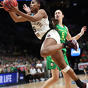 March 31, 2019; Portland, OR, USA; Mississippi State Bulldogs forward Anriel Howard (5) drives around Oregon Ducks guard Maite Cazorla (5) in the first half  of  the Elite Eight of the NCAA Women's Tournament at Moda Center.<br /> Photo by Jaime Valdez