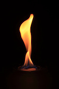 Barium chloride (BaCl2) emits a red-orange glow in a flame test.  In this experiment the barium chloride is placed in a watch glass and saturated with ethanol.  The burning ethanol heats the barium to show the characteristic orange flame.