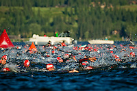Hundreds of triathletes converge at a turning point of the 2.4-mile swim during Sunday's Ford Coeur d'Alene Ironman.