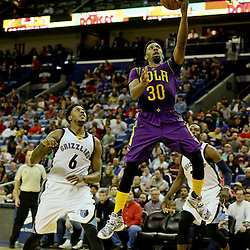 Feb 1, 2016; New Orleans, LA, USA; New Orleans Pelicans guard Norris Cole (30) shoots over Memphis Grizzlies guard Mario Chalmers (6) during the second half of a game at the Smoothie King Center. The Grizzlies defeated the Pelicans 110-95. Mandatory Credit: Derick E. Hingle-USA TODAY Sports