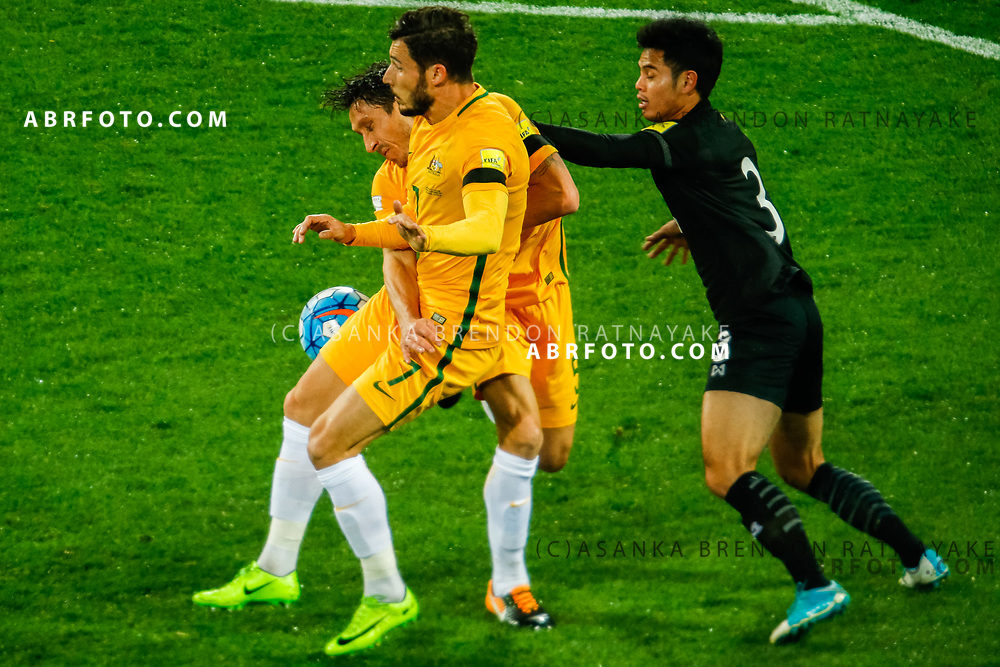 MELBOURNE, AUSTRALIA - SEPTEMBER 5 :  Mark Milligan of the Australia Socceroos and Mathew Leckie of the Australia Socceroos collide during the Stage 3 Group World Cup Football Qualifiers between Australia Vs Thailand at the Melbourne Rectangular Stadium, Melbourne, Australia 5 September 2017.